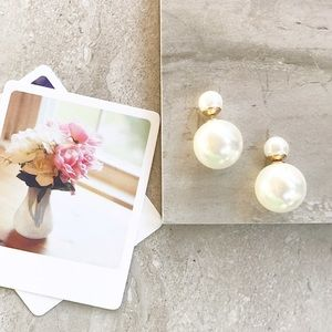 Two sided pearl earrings.